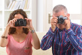 Mature couple taking pictures — Stock Photo