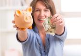 Woman saving money — Stock Photo