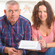 Couple signing property insurance contract — Stock Photo #48658163