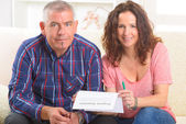 Couple signing property insurance contract — Stok fotoğraf