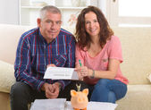 Couple signing life insurance contract — Stok fotoğraf