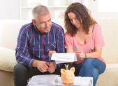Couple signing credit insurance contract — Стоковое фото