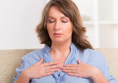 Woman practicing energy medicine — Stock Photo