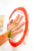 Finger painting paint with palms — Stock Photo