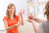 Deaf woman learning sign language — Stockfoto