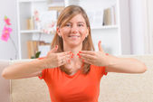 Deaf woman using sign language — Stock Photo