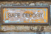 Weathered copper bank placard — Stock Photo