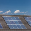 Stock Photo: Grouped solar panels on roof