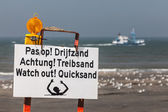 Beach sign warning for quicksand — Stock Photo