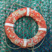 Old weathered lifebuoy — Stock Photo