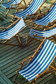 Striped beach chairs — Stock Photo