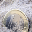 Euro in sand — Stock Photo