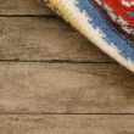 Ethnic rug with background — Stock Photo #13163866