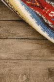 Ethnic rug with background — Stock Photo