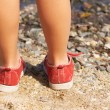 Children's legs in the sand — Stock Photo