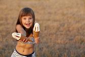 Girl holding ice cream — Stock Photo