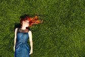 Red haired girl on the grass — Stock Photo