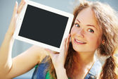 Girl with tablet computer — Stock Photo