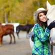 Woman with a horse — Stock Photo #33258989