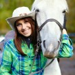 Woman with a horse — Stock Photo #33259005