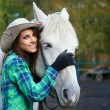 Woman with a horse — Stock Photo #33259281