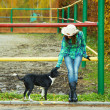 Cowgirl with a dog — Stock Photo