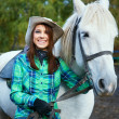 Woman with a horse — Stock Photo #33259315