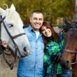 Couple with horses — Stock Photo #38276939