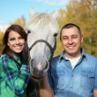 Couple with horses — Stock Photo