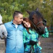 Couple with horses — Stock Photo #38277371