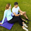 Sports couple using digital tablet — Stock Photo #39449351