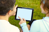 Sports couple using digital tablet — Stock Photo