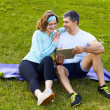 Sports couple using digital tablet — Stock Photo #39451569