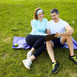 Sports couple using digital tablet — Stock Photo #39452079