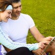 Sports couple using digital tablet — Foto de stock #39452169