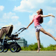Young mother with a stroller — Stock Photo #40848989