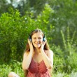 Womwith Headphones Outdoors — Stock Photo #41295753