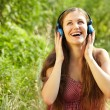 Stockfoto: Womwith Headphones Outdoors