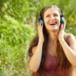 Foto de Stock  : Womwith Headphones Outdoors