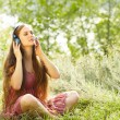 Womwith Headphones Outdoors — Stock Photo #41295943