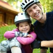 Dad and daughter in helmet — Stock Photo #41296633