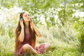 Woman with Headphones Outdoors — Stock Photo