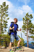 Man with backpack hiking in the mountains — Stock Photo