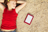 Girl lying on the sand — Stock Photo