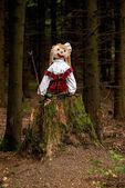 Puppet on a tree stump — Stock Photo