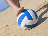 Foot stepping on a ball on the beach 2 — Stock Photo