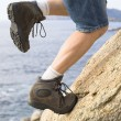 Stock Photo: Man climbing a rock