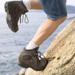 Man climbing a rock — Stock Photo