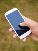 Man hand touching screen on modern mobile smart phone 2 — Stock Photo