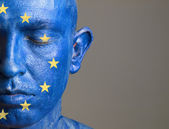 Man with his face painted with the flag of European Union (4) — Stock Photo